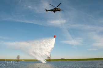 Cougar RNLAF training fighting fire with Bami-Bucket - the Netherlands 2009